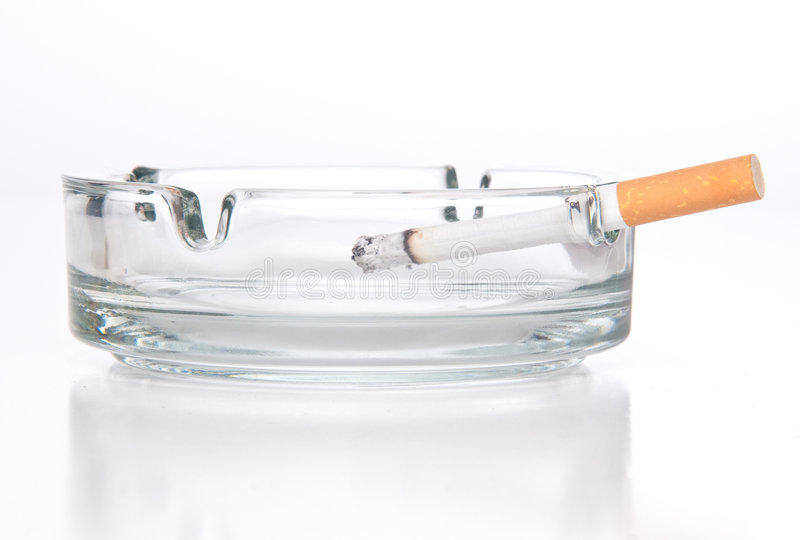 Cigarette in ashtray. Isolated reflex royalty free stock photo
