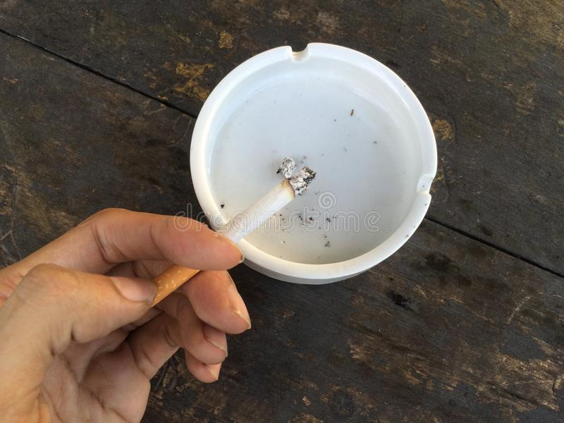Cigarette on ashtray. On a table royalty free stock photos