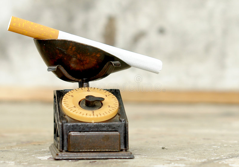 Cigarette on balance. With light effects. photo image stock images