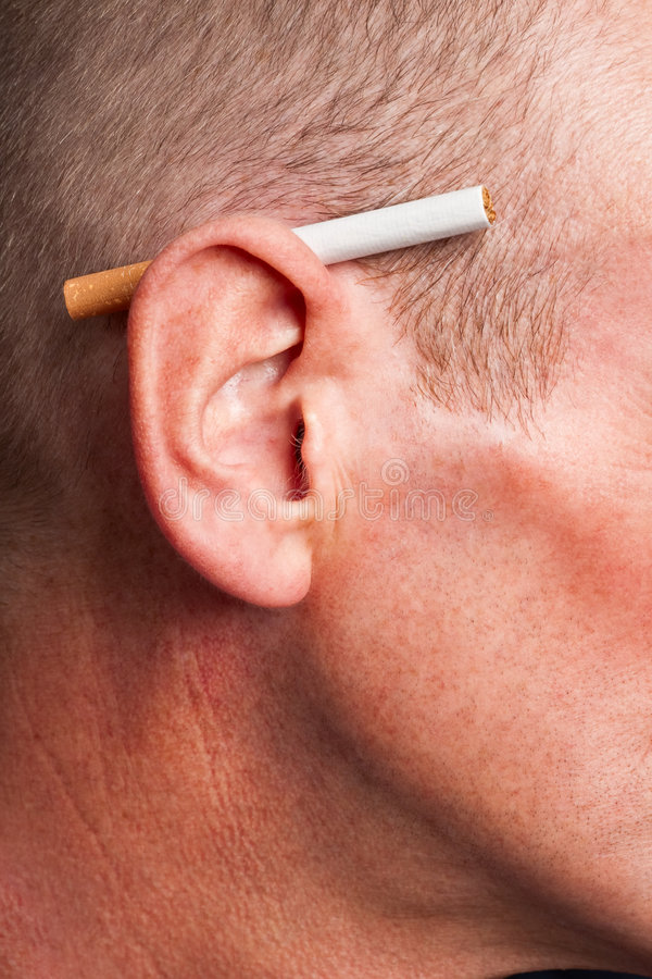 Cigarette behind ear stock images
