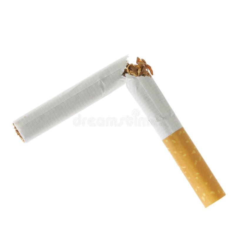 Cigarette cassée d'isolement photographie stock