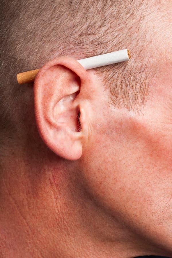 Download Cigarette Derrière L'oreille Photo stock - Image du oreille, projectile: 8654044
