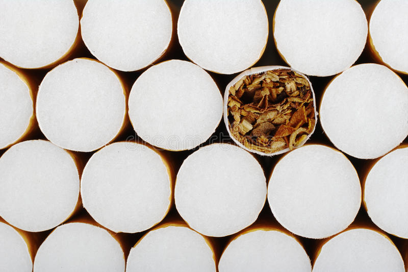 Cigarette without Filter. In between ones with filter as background stock image
