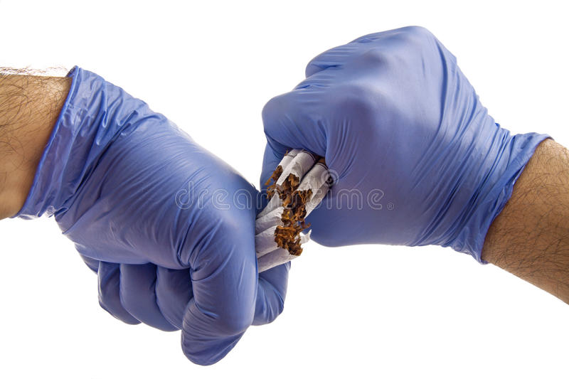 Cigarette With Gloved Hands Stock Image