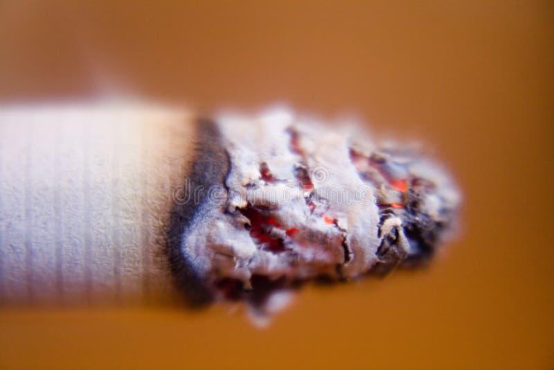 Cigarette's lit top closeup stock image