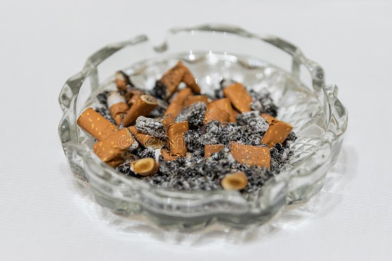 Cigarette stubs and ash royalty free stock photo