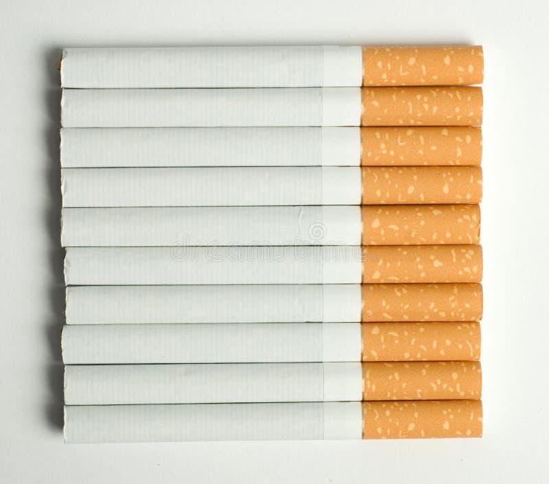 cigaretter tio arkivfoto