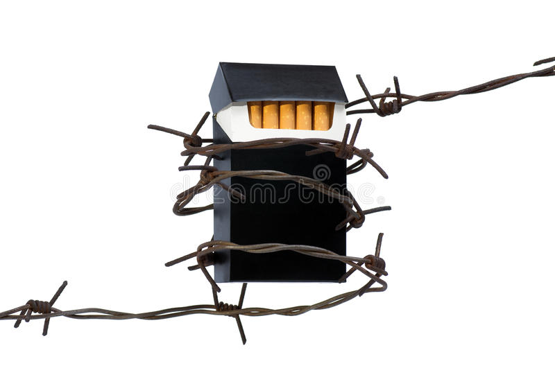 Cigarettes In Barbed Wire Royalty Free Stock Photos