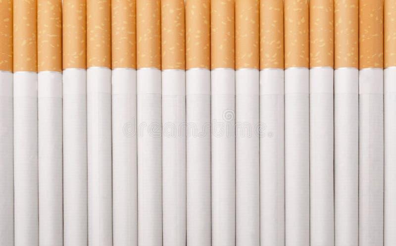 Cigarettes comme fond photographie stock