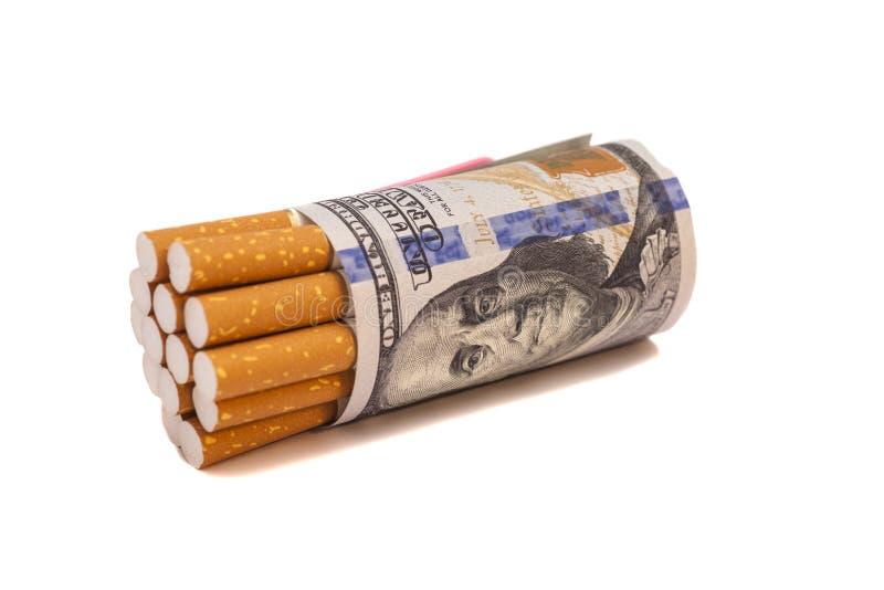 Cigarettes et argent photos libres de droits