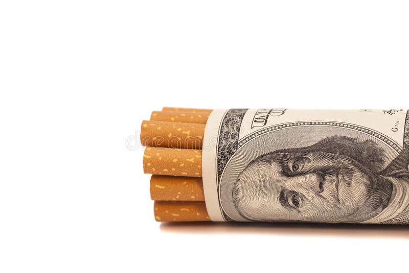 Cigarettes et argent images libres de droits