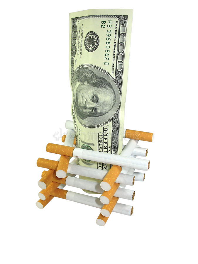 Cigarettes with money. Healthcare and Health insurance cost concept. Cigarettes with money royalty free stock images