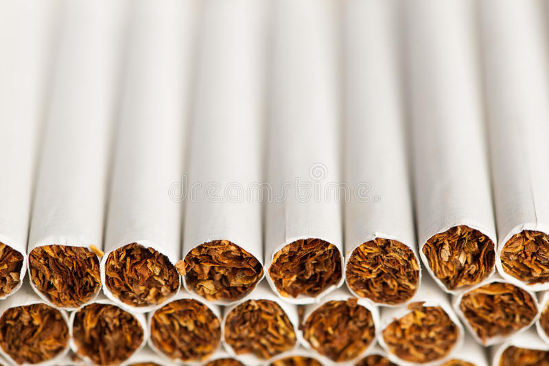 Cigarettes production line. With copy-space stock photos