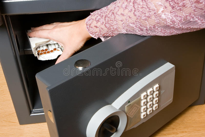 Cigarettes in a safe stock photo