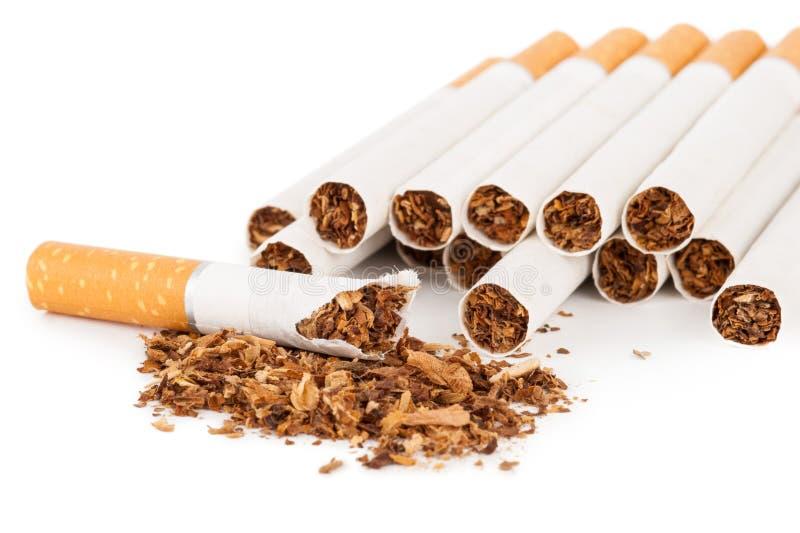 Cigarettes sur le fond blanc photos libres de droits