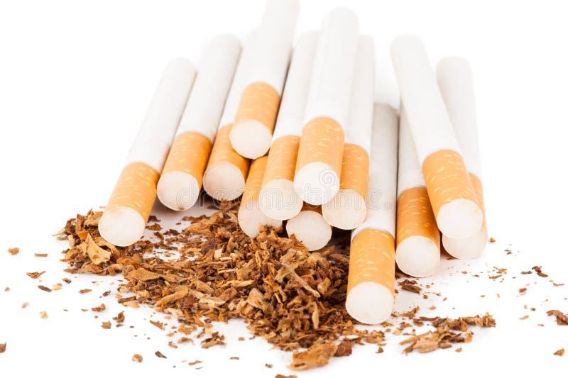 Cigarettes sur le fond blanc image stock