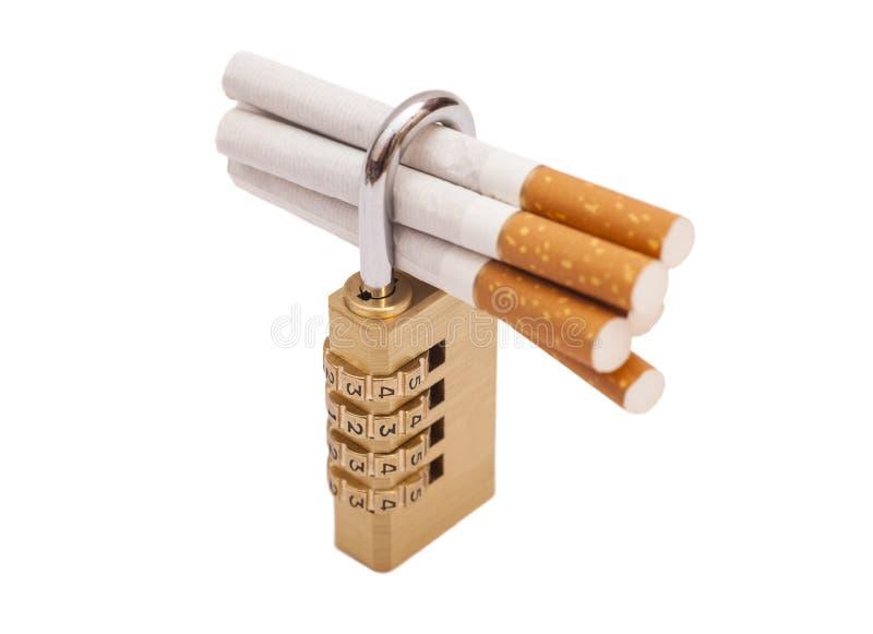 Cigarettes verrouillées photographie stock libre de droits