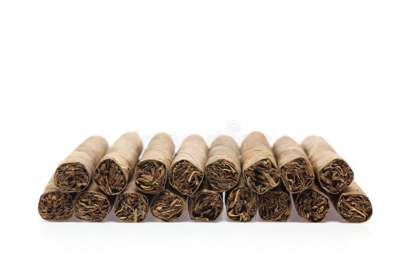 Cigarillo à un arrière-plan blanc image libre de droits