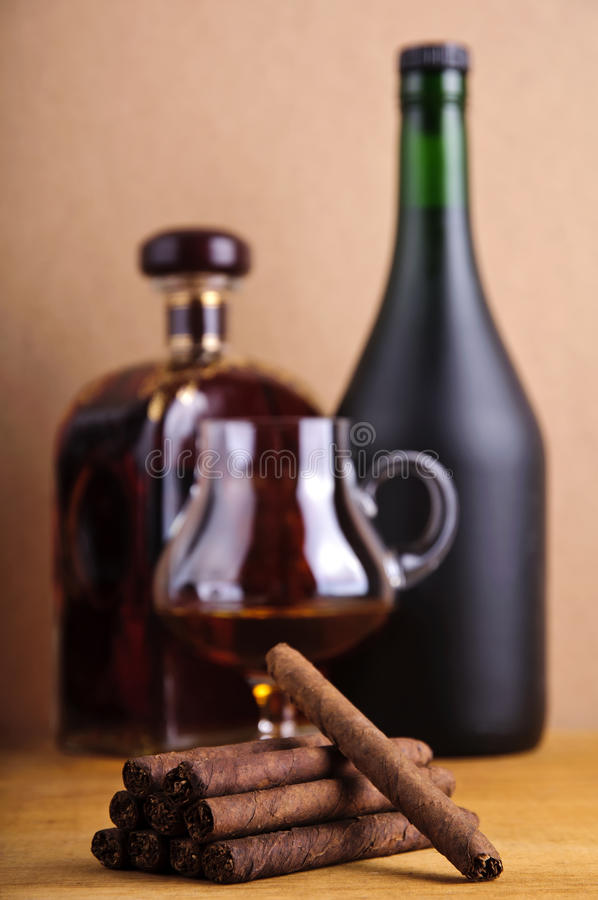 Cigarillos and brandy stock photo