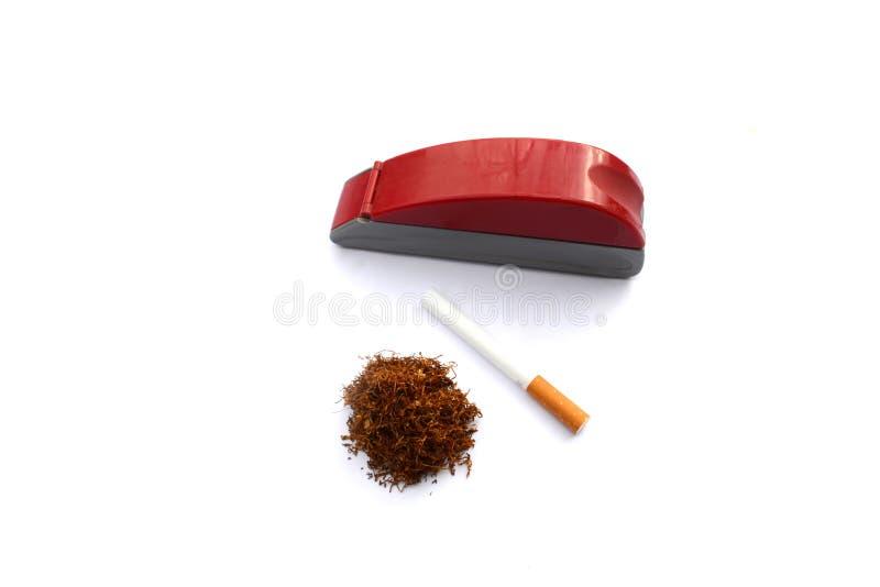 Cigarrillo con la máquina y el tabaco del cigarrillo foto de archivo libre de regalías