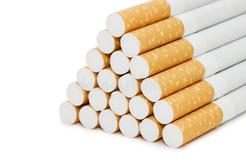Cigarrillos sobre blanco fotografía de archivo