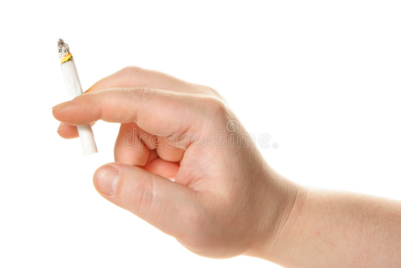 Cigarro humano da terra arrendada da mão fotografia de stock royalty free