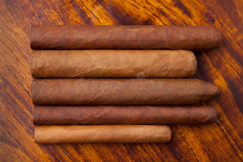 Cigars of different sizes stock image