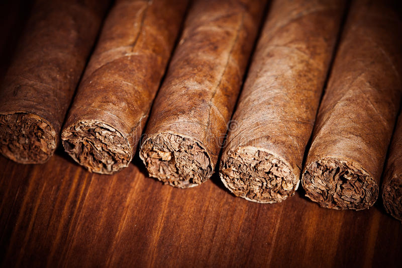 Cigars on wooden background stock photo