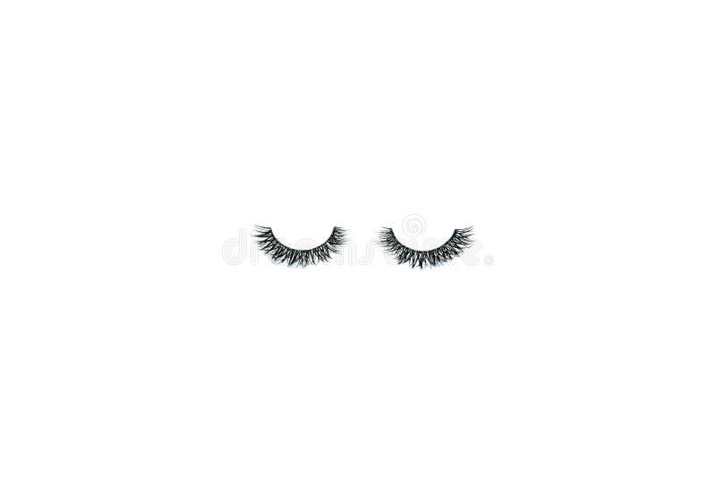 Cigli falsi lunghi neri semplici disposti sotto forma di un essere umano fotografia stock libera da diritti
