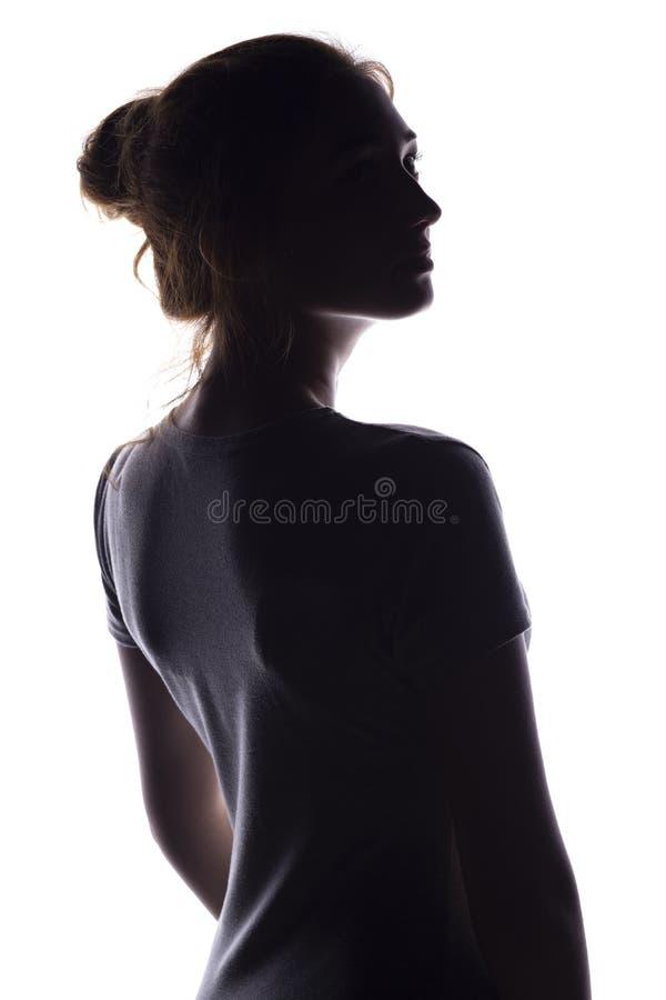 Cijfer van een sensuele jonge vrouw die achteruitgaan en, een mooi meisje met uitgelezen haar op een geïsoleerd wit zich omdraaie royalty-vrije stock afbeelding