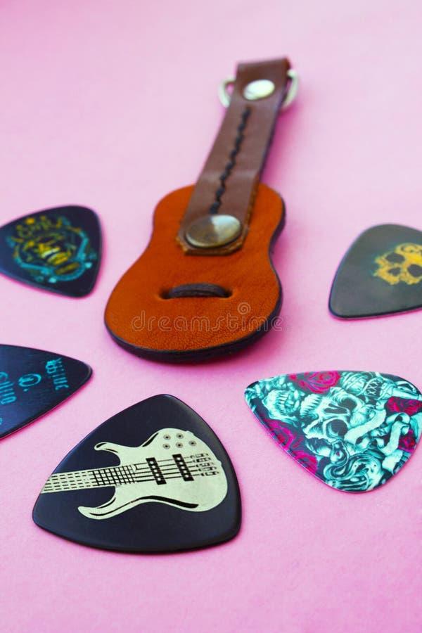 Cijfergitaar en gitaaroogsten stock fotografie