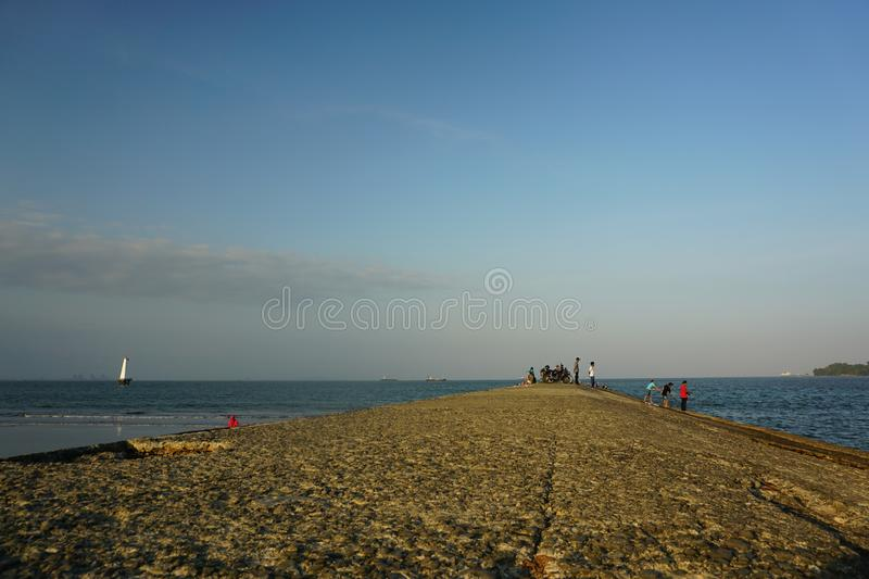 Waiting For Sunset At Teluk Penyu Beach Cilacap. Cilacap, Indonesia - July 21, 2019 : Teluk Penyu Beach Cilacap Central Java Indonesia stock photos