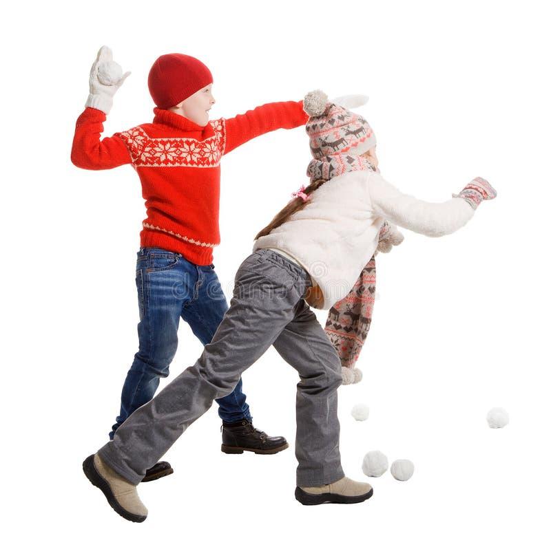 Cildren que joga na neve fotografia de stock