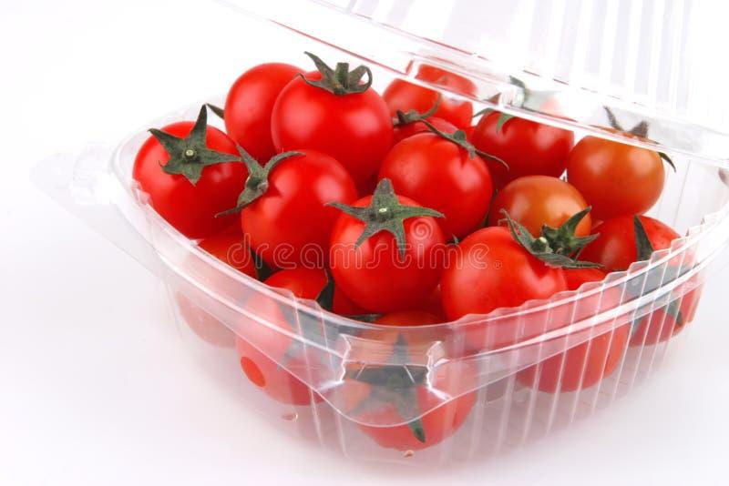 Ciliegia del pomodoro in casella fotografia stock libera da diritti