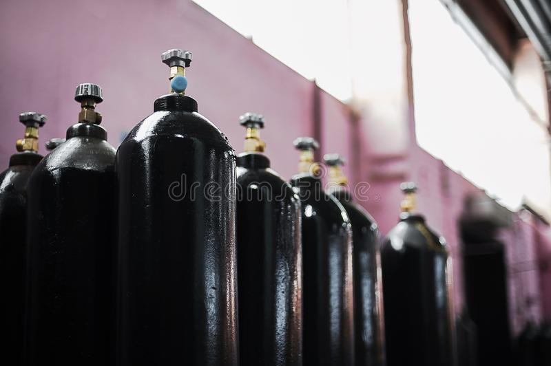 Cilinder with carbon dioxide. Tanks with compressed gas for industry. Liquefied oxygen production. Factory. Cilinder with carbon dioxide. Tanks with compressed stock photography