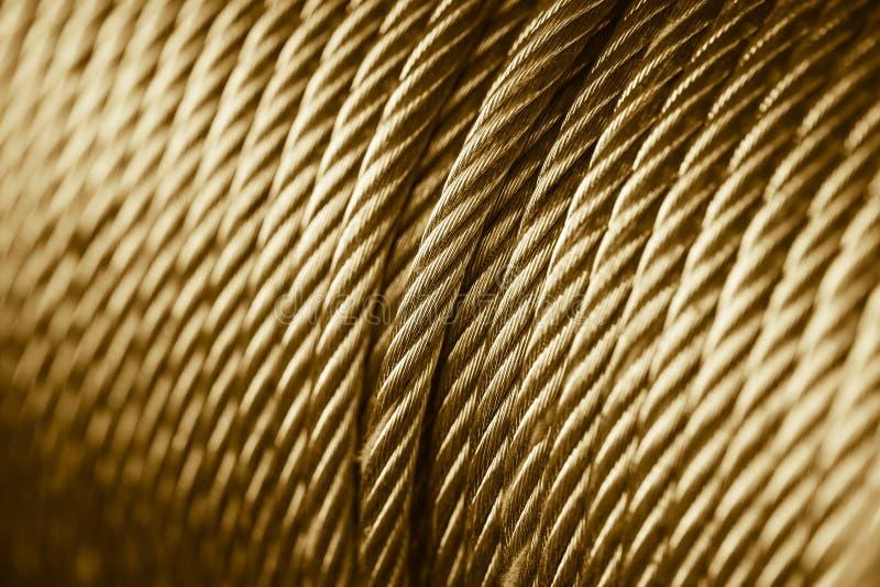 Cilindro do estilingue da corda da cor do ouro imagens de stock royalty free