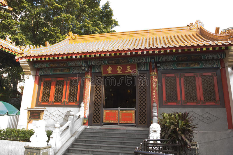 CIM inmortal Insence de Hall Sik Sik Yuen Wong Tai Sin Temple Religion Great Wong Prayer Kau de tres santos fotos de archivo