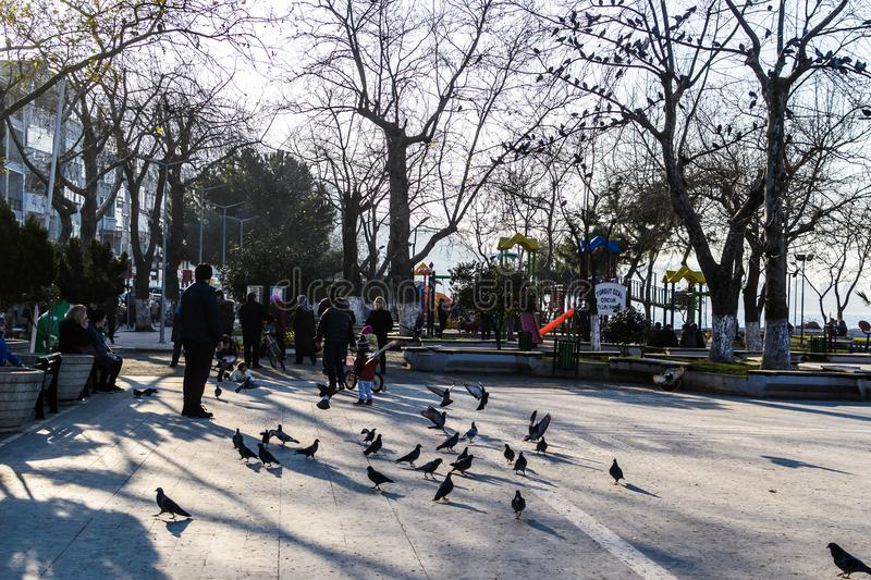 Cinarcik Town Center - Turkey. Town Center of Cinarcik with the view from its everyday life where new apartments, old homes and stores, Turkish tea houses, cafes stock photography
