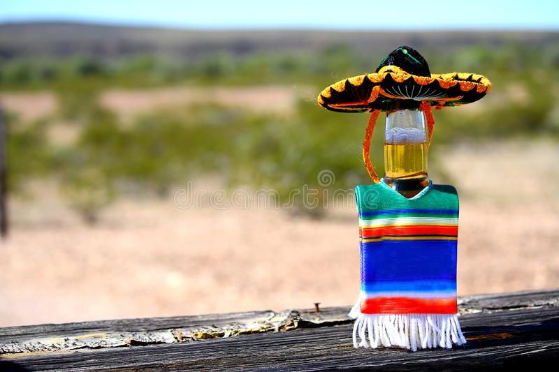 Cinco de Mayo beer with sombrero and poncho. royalty free stock images