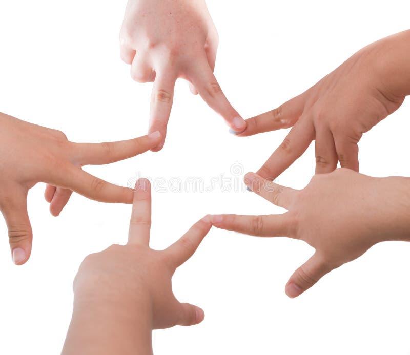 Cinco amigas que llevan a cabo las manos en una forma de la estrella imagenes de archivo