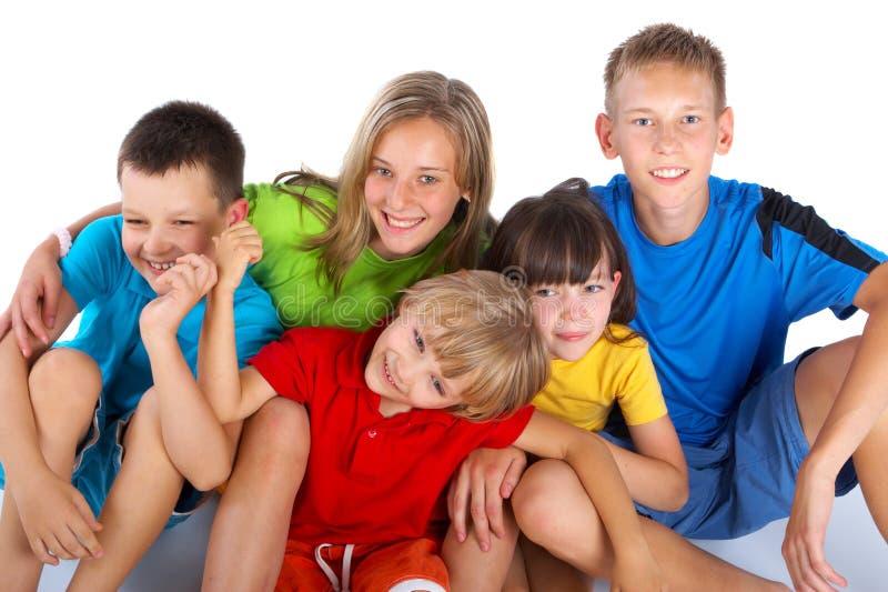 Cinco crianças felizes imagens de stock