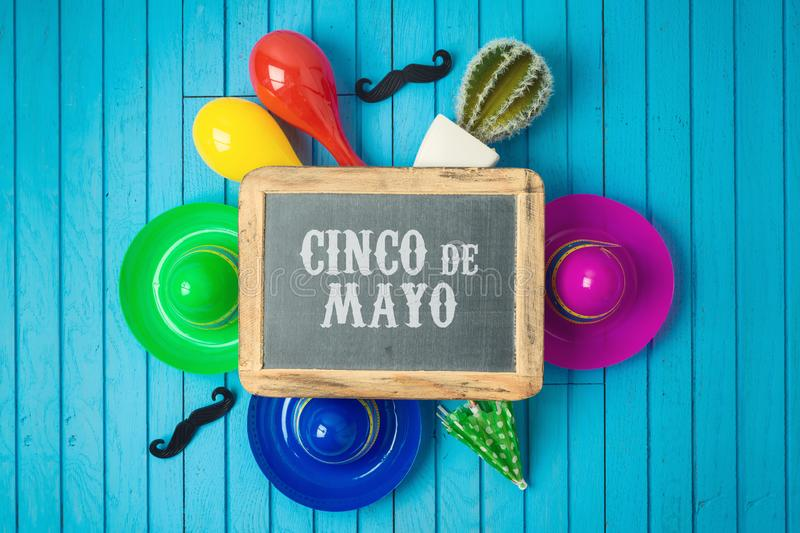 Cinco de Mayo holiday background with chalkboard, Mexican cactus and party sombrero hat on wooden board. Top view from above stock photo