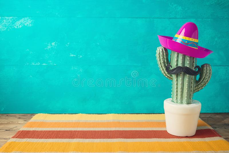 Cinco de Mayo holiday background with Mexican cactus and  party sombrero hat. On wooden table stock images