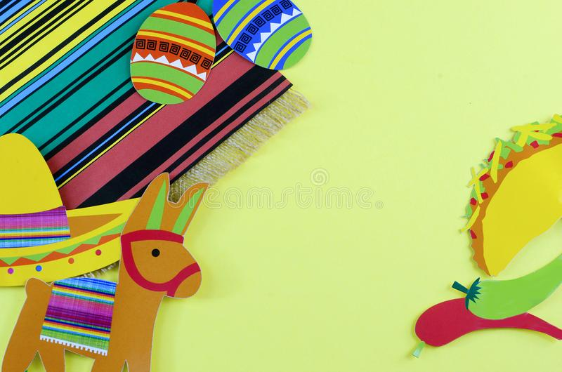 Cinco de Mayo image with copy space on yellow background surrounded by colorful Mexican party props royalty free stock photos