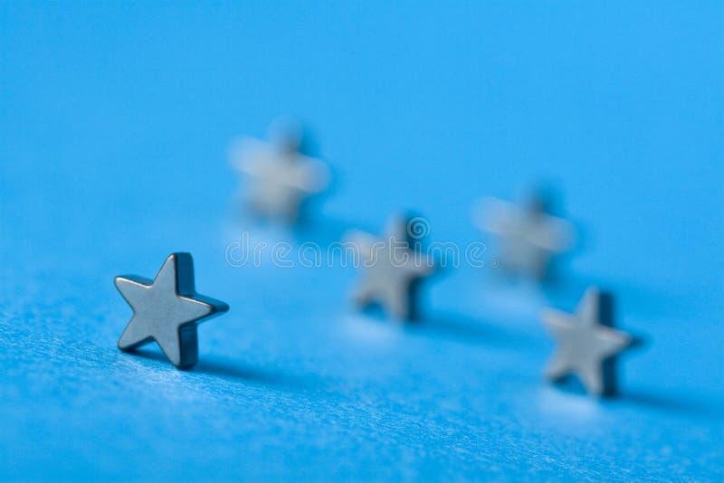 Cinco estrelas imagens de stock