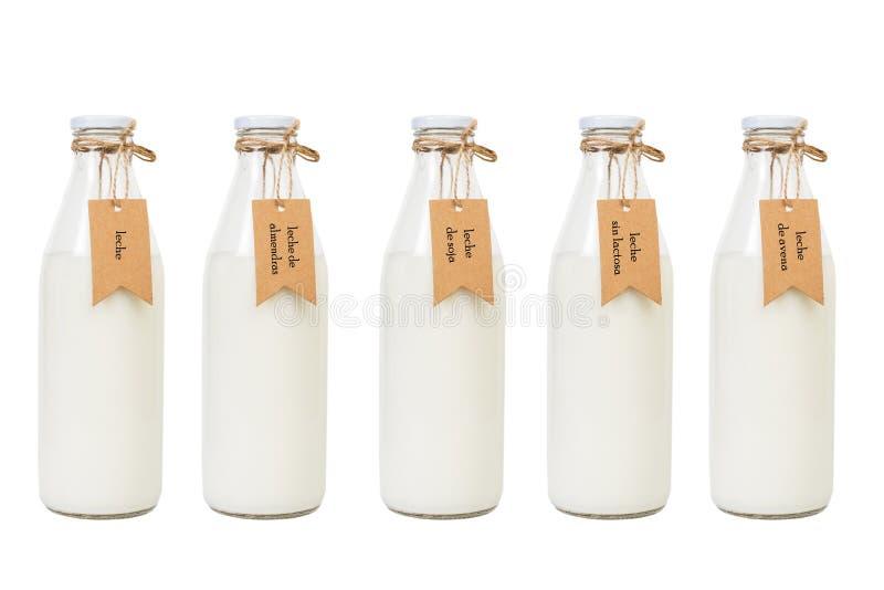 Cinco garrafas do leite fotos de stock royalty free