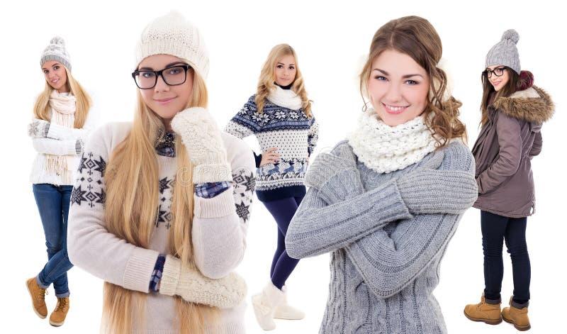 Cinco jovens mulheres bonitas na roupa do inverno isolada no branco imagem de stock