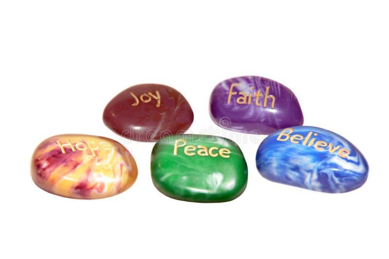 Cinco pedras inscritas da afirmação imagem de stock