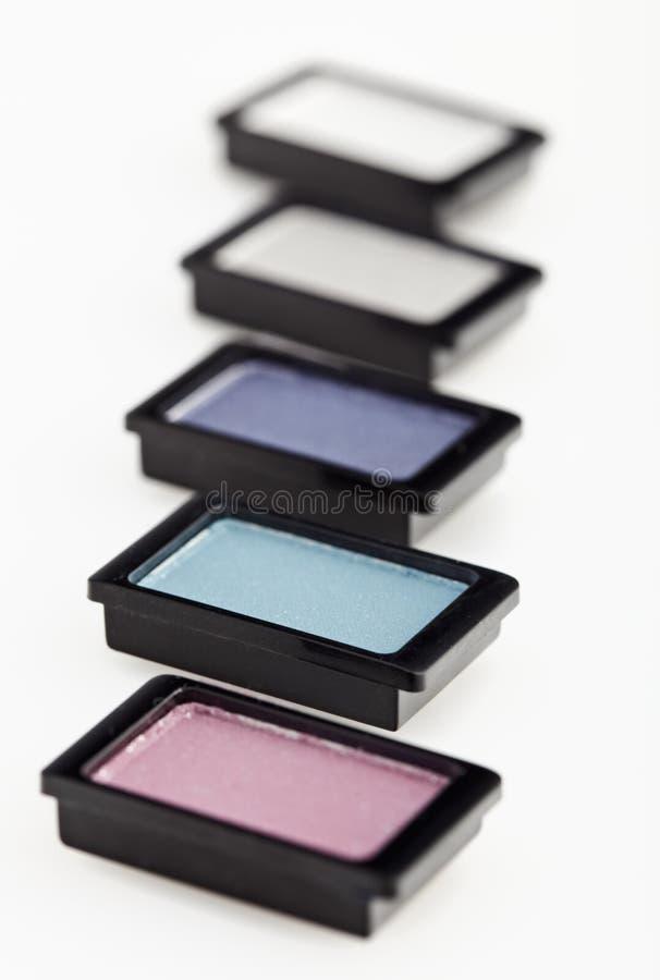 Cinco pequeños sombreadores de ojos multicolores imagen de archivo libre de regalías