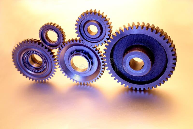 Cinco rodas denteadas imagem de stock